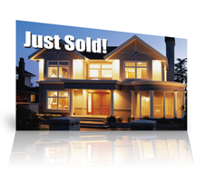 sample of a just sold postcard design showing a large house illuminated at night